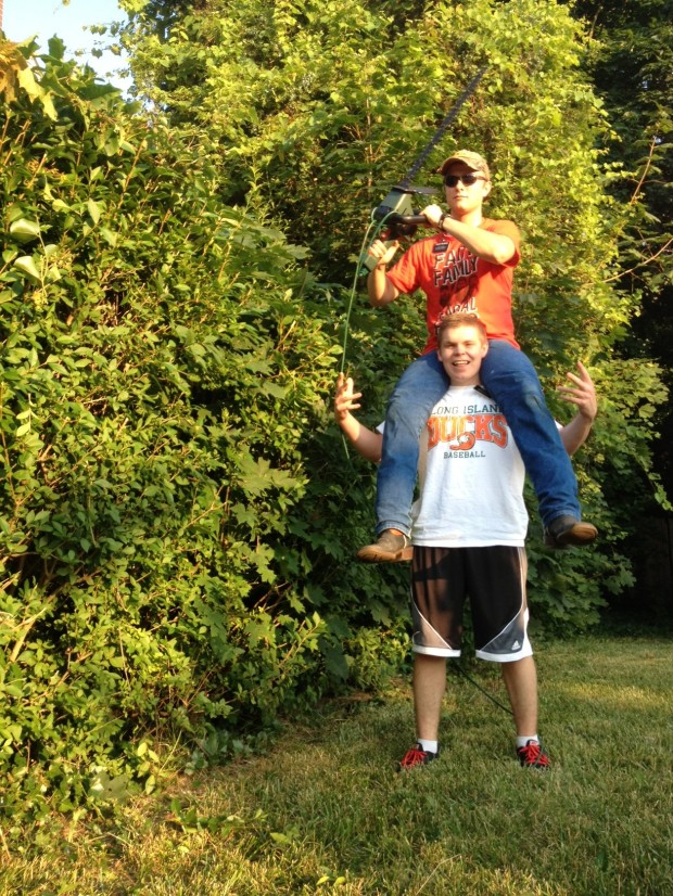 Sean and Elder F. trimming bushes